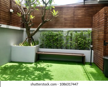 Backyard landscape design with artificial grass garden