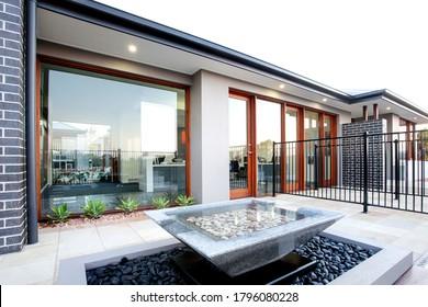Backyard of luxury house with big glass door and windows