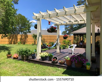 Backyard oasis with a shadow box fence and pergola