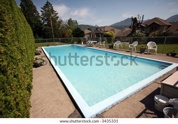 Backyard pool in wealthy estate