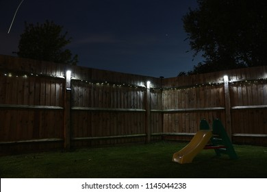 Backyard with solar lights at night