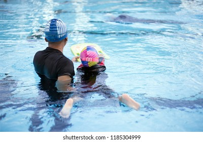 backyard of swimming coach activity in swimming pool.