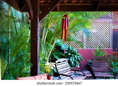 Backyard, tropical pergola. Full color bamboo wind chime.