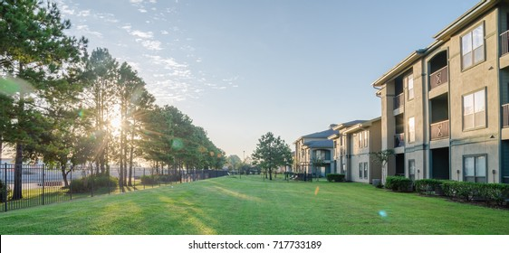 Backyard of a typical apartment complex building in Humble, Texas, USA at sunrise.