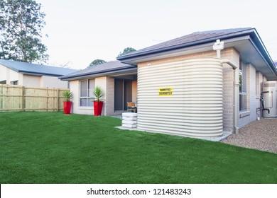 Backyard with water tank of Australian townhouse