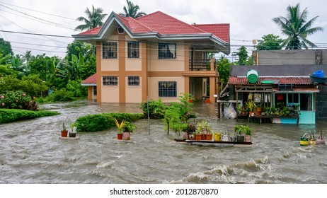 Baco, Oriental Mindoro, Philippines - July 23, 2021. Heavy monsoon rain linked to Typhoon In-fa causes severe flooding on residential property near Calapan City.