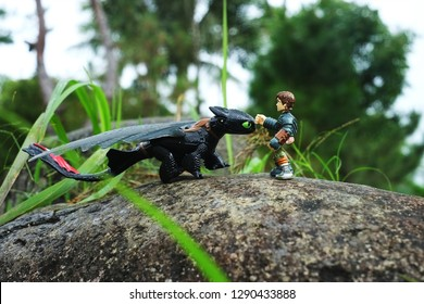 Bacolod City/Philippines - December 31, 2018: Outdoor photography of How to Train Your Dragon or HTTYD toy characters Toothless and Hiccup depicting  a taming scenario based from the film