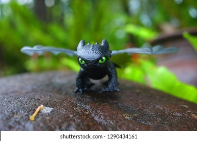 Bacolod City/Philippines - December 31, 2018: Macro shot of Toothless  from the film How to Train Your Dragon or HTTYD. Toy character standing on a rock as if will attack
