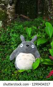 Bacolod City/Philippines - December 31, 2018: Studio Ghibli's Totoro character stands on a forest area