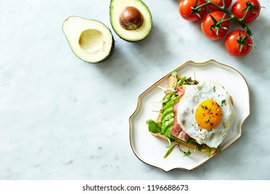 Bacon and avocado toast with fried egg