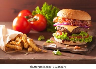 bacon cheese hamburger with beef patty tomato onion