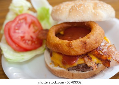 Bacon Cheeseburger with Onion Ring on Sesame Seed Bun