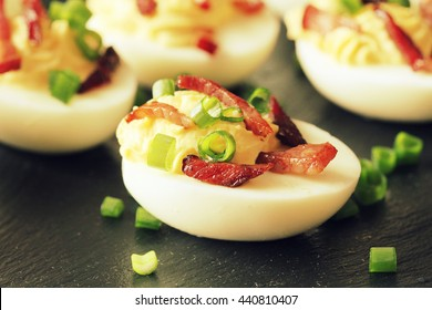 Bacon Deviled Eggs on black background