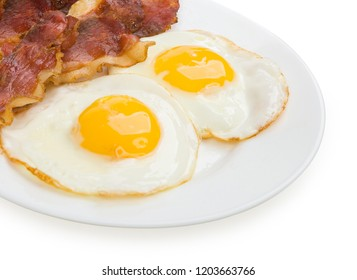 bacon and eggs isolated on a white background.