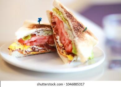 Bacon, Eggs, Lettuce and Tomato breakfast sandwich.