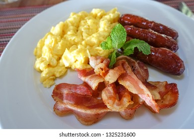 Bacon, Eggs, and Pork Sausage on White Plate at Vacation Resort