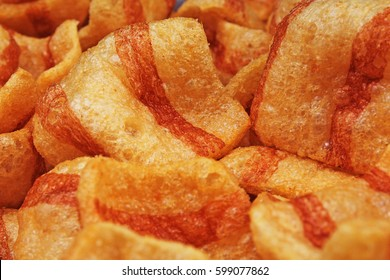 Bacon flavored snacks. Bacon chips flips background pattern texture.
