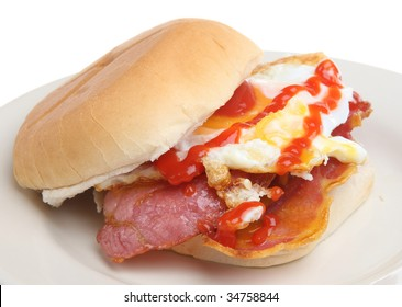 Bacon and fried egg roll with tomato ketchup