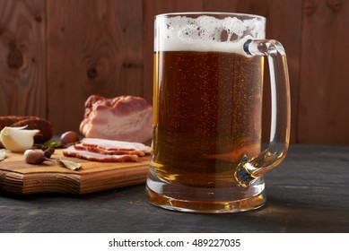 bacon and glass of beer on a wooden table