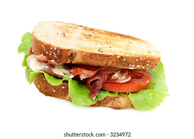 Bacon, lettuce and tomato sandwich on toasted wholewheat bread, with creamy mayonnaise.