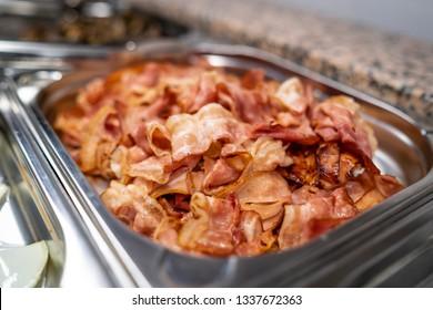 Bacon on inox steel tray