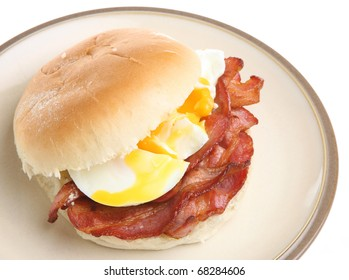Bacon and poached eggs roll