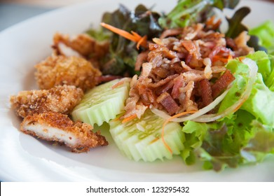 Bacon salad with deep fried chicken