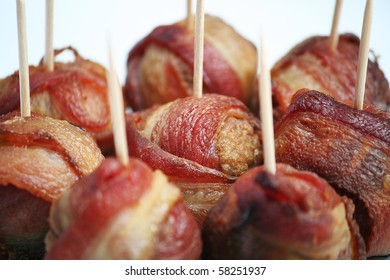 Bacon Wrapped Meatballs with Toothpicks on White