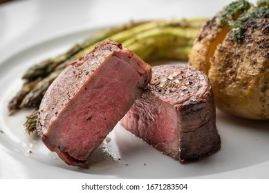 bacon wrapped tenderloin steak on white plate