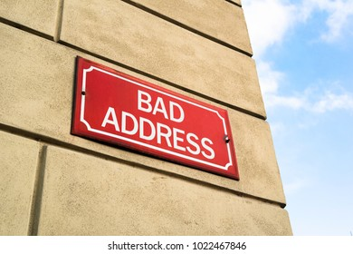 Bad Address - signboard on the wall of house - street in problematic neigborhood and residential location. City, towns, urbanic destination and negativity - problems, troubles, teriorial exclusion