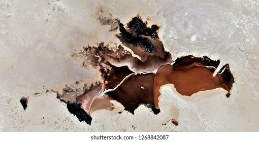 Bad augury, black gold, polluted desert sand, tribute to Pollock, abstract photography of the deserts of Africa from the air, aerial view, abstract expressionism, contemporary photographic art,