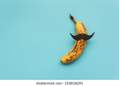 Bad banana with black paper mustache. Sexually transmitted diseases concept.