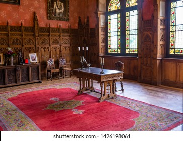 Bad Bentheim, Germany - June 9, 2019. Ancient  interior of 11th century Bentheim castle. The castle is completely build from sandstone blocks. Old, antique wooden desk.