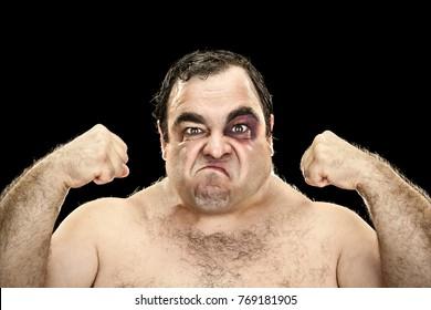 bad big fat boxer show muscles portrait on black background