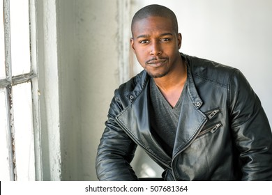 Bad boy confident sexy masculine man serious look in eyes tough edgy african american