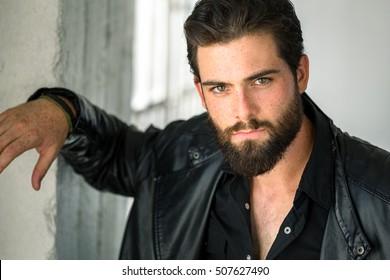 Bad boy tough macho masculine strong male intense passionate gaze leather jacket
