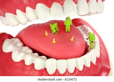 Bad breath concept. Miniature HAZMAT team inspects a tongue looking for the source of bad breath odors.
