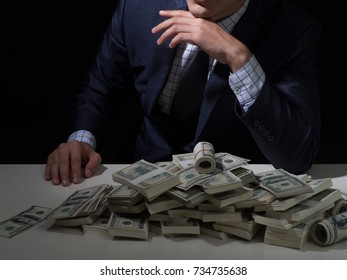 bad business man with dollar packs.Money Cash Finance Corruption Illegal Transaction Concept.