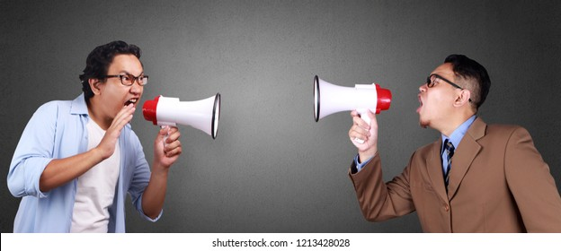 Bad communication concept. Two man shouting screaming at each other with megaphone. Composite image, one person recomposed as two different men