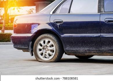 Bad day, car flat tire.