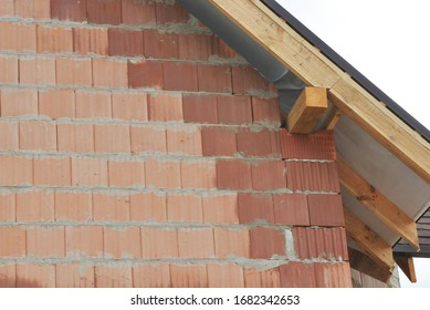 A bad example of masonry, bricklaying, using wet bricks under the roofing construction.