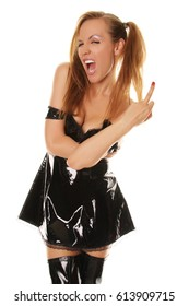 Bad Girl Posing in the Black latex rubber dress and shiny fetish pvc thigh high boots as bdsm chic for catalog