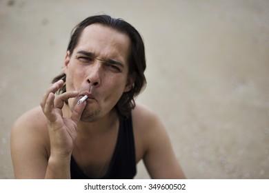a bad guy smokes a cigarette
