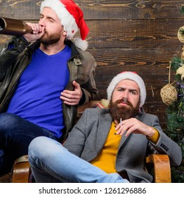 Bad habits to kick before the end of year. Get rid of harmful habits. How to break bad habits. Men drink champagne and smoking. New years resolution. Brutal men celebrate new year near christmas tree.