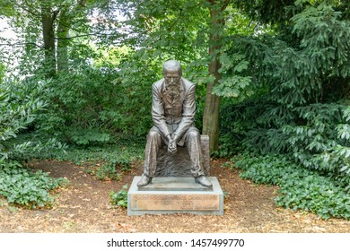 Bad Homburg, Germany -July 21, 2019: statue of  Fjodor Dostojewski by artist Nikolai Karlychanow in the public park in Bad Homburg.