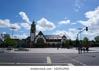 BAD HOMBURG, GERMANY - JUNE 09: Tourists and travelers on the forecourt of the historic main train station on June 09, 2019 in Bad Homburg.