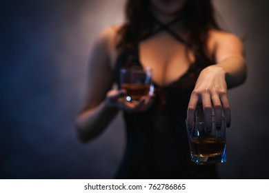 Bad influence. Woman offering alcohol and seducing. Amoral and indecent lifestyle concept