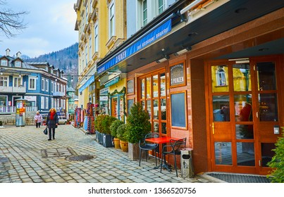 BAD ISCHL, AUSTRIA - FEBRUARY 20, 2019: Franz Joseph Strasse is popular for many bars, cafes and restaurants, offering tasty local cuisine, beverages and Austrian beer, on February 20 in Bad Ischl