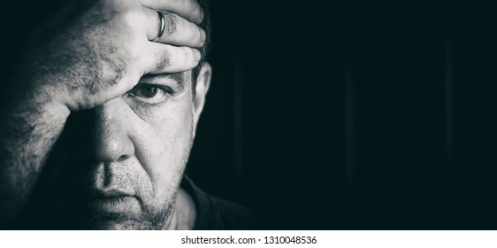 Bad mood. Mature men closeup portrait.