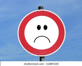 Bad mood sign, traffic sign on blue sky